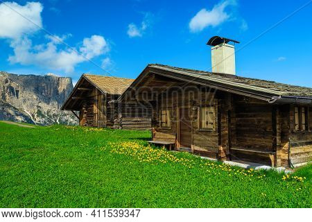 Admirable Wooden Chalets On The Alpine Green Fields And High Mountains In Background, Alpe Di Siusi,