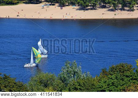 Two Yachts On The Dnieper River. Friends On Yachts On River. Sports Or Recreation On The Water. Race