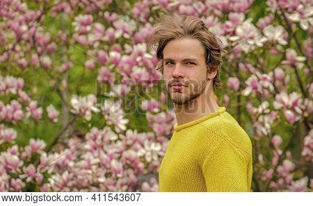 Spring Beauty. Modern Hipster Enjoy Blossom. Springtime Concept. Guy Relax In Flowers Park. Botanica