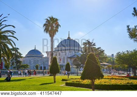 The Blue Mosque At Sultanahmet Square In Istanbul. View From The Park Where People Walk. Turkey , Is
