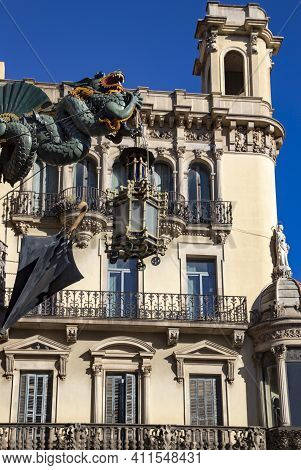 Spain, Barcelona, January, 2021 - Gothic Buildings With A Flying Dragon On La Rambla In Barri Gothic