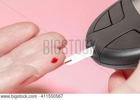 Health Care Concept. Close-up View Of Woman Fingers Doing Blood Test For Sugar Level (glucose) In Bl