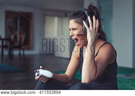 Young Caucasian Angry Gamer Woman Shouting While Playing Consol View