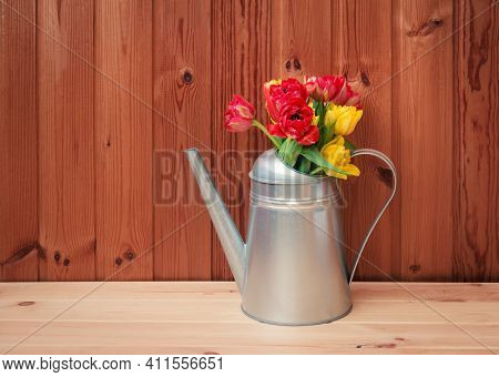 Bouquet Of Colorful Tulips In Watering Can On Wooden Table.  Spring Gardening Concept. View With Cop