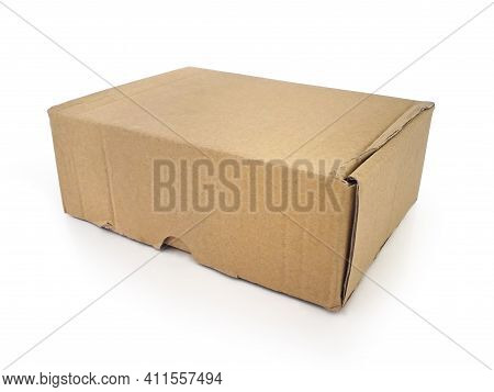 Closed Rectangular Brown Cardboard Box Isolated On White Background. Close Up Of Self-assembling Car