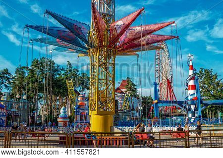 Kharkiv, Ukraine - August 29, 2020: Amusement Gorky Park - Colorful Carousels, Ferries Wheel And Peo