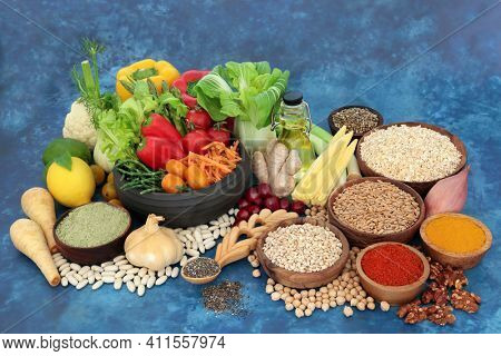 Worlds healthiest vegan super food collection for health and well being with health food high in protein, omega 3, antioxidants, dietary fibre,  vitamins and lycopene. Immune boosting concept Top view