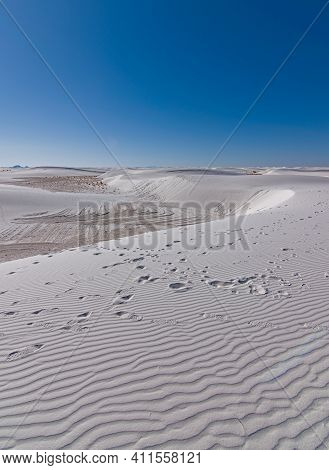 White Sand Dunes Showing Wind Ripples In Formnations Of Gypsum Hills At National Monument Park In So