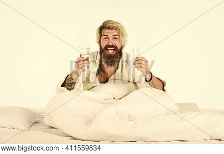 Hangover Concept. Man Painful Face Waking Up In Morning. Hipster Drink Water Take Medicines. Headach