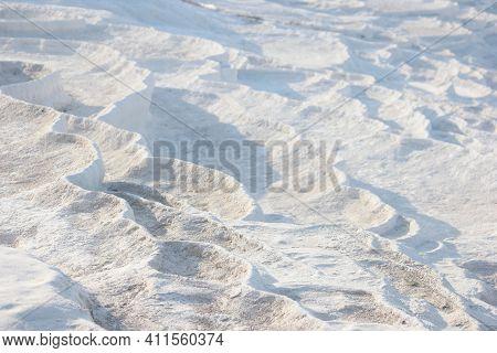 Travertine Terrace Formations, Pamukkale, Turkey. Limestone Travertine Thermal Springs Texture Backg