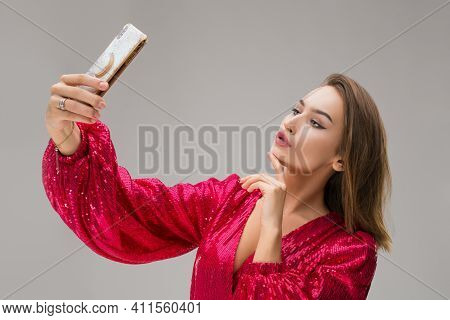 Happy Young Woman Look At Shiny Mobile Phone