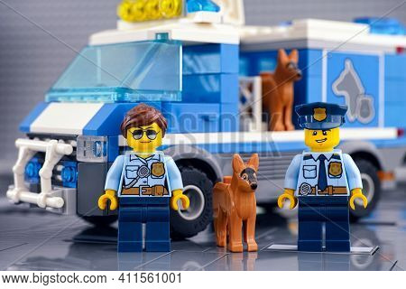 Tambov, Russian Federation - March 03, 2021 Lego Policewoman And Policeman Minifigures Standing Near