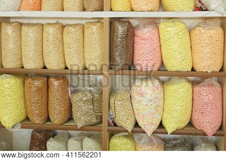 Various Whole Grain Cereals On The Wooden Shelf. Different Types Of Legumes And Cereals In Plastic B