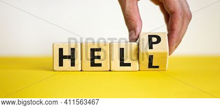 Hell Or Help Symbol. Businessman Turns A Cube And Changes The Word 'hell' To 'help'. Business, Psych