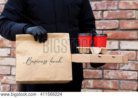 Food Delivery Home Wearing A Mask And Gloves.safe Food Delivery.pizza Delivery To Your Home And Offi