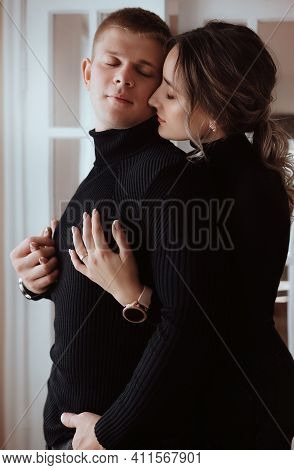 Portrait Of Happy Loving Couple. Trend Of 2021 Total Black