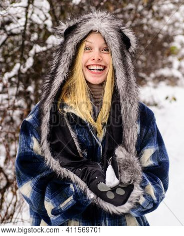 Wintertime. Smiling Woman In Warm Clothing With Snowball. Girl Playing With Snow. Season Of Winter.