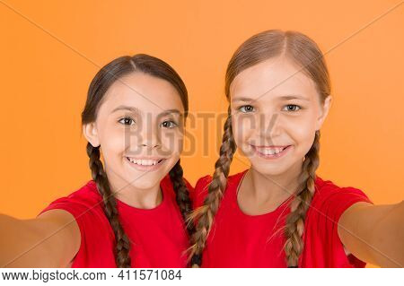 Real Heppiness. Selfie Girls. Small Girls Make Selfie On Phone. Having Fun. Sisterhood And Friendshi