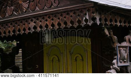Old Wooden House With Carvings. Stock Footage. Monument To Russian Wooden Architecture. Parts Of Ext