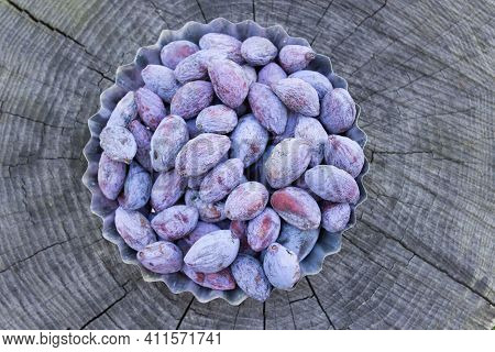 Dried Plums, Ugly Plum On A Wooden Table. Diy Prunes.