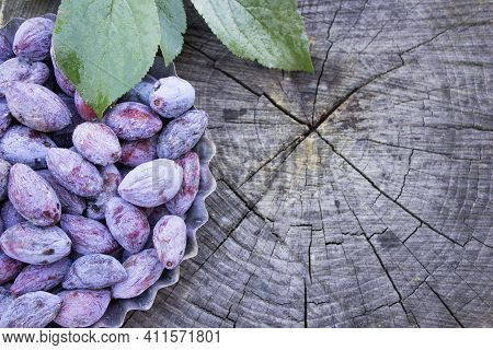 Dried Plums, Ugly Plum On A Wooden Table. Diy Prunes For Copy Space.