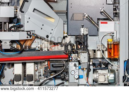 The Interior Of A Modern Automated Edge Banding Machine For Hpl, Cpl, Polyester, Pvc, Abs, Pp, Resin