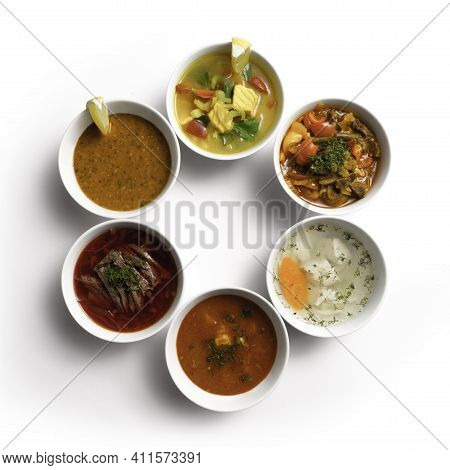 A Large Set Of Different Oriental Soups. Borscht With Beef And Sour Cream, Lagman With Lamb And Adzh