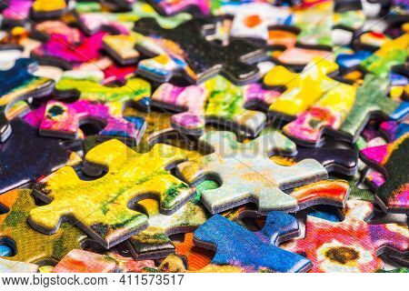 A Lot Of Colorful Scrambled Puzzle Pieces. Abstract Background Of Scattered Puzzle Pieces. Textured