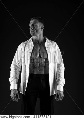 Strong And Elegant. Muscular Man Black Background. Formal Style. Fashion Wardrobe. Trendy Menswear.