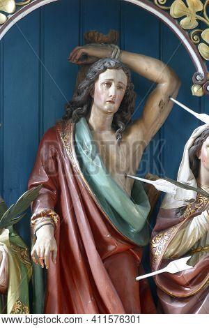 OSTARIJE, CROATIA - JULY 14, 2013: Saint Sebastian, statue on the altar of Saint Fabian and Sebastian at Our Lady of Miracles Parish Church in Ostarije, Croatia