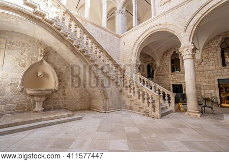 Dubrovnik, Croatia - Aug 22, 2020: Atrium Stairs With Bronze Statue Inside Rectors Palace In Old Tow