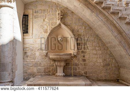 Dubrovnik, Croatia - Aug 22, 2020: Atrium Fountain Inside Rectors Palace In Old Town