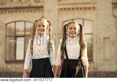 School Friends. Happy Friends Back To School. Small Friends Wear Uniform Outdoors. Fashion Look Of L