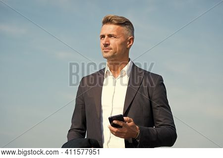 Communicating On The Go. Handsome Man Hold Mobile Phone Outdoors. Business Communication. Mobile Mar