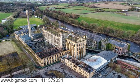 Sion Mills, Northern Ireland- Feb 27, 2021: Herdman' Abandoned Flax Mill On The Banks Of The Mourne
