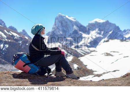 Girl Looks At Beautiful Himalayas Mountains. Everest Base Camp Trek. Way From Gokyo To Dragnag.