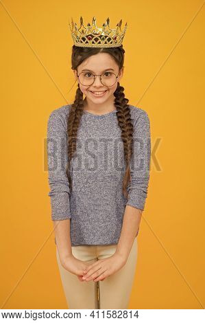 Ambitious Girl. Little Princess Yellow Background. Small Girl Wear Luxury Crown. Happy Girl In Casua