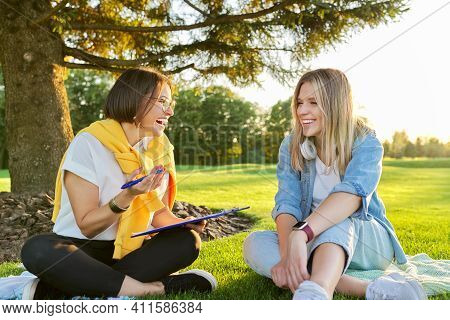 Female Teacher Meeting With Student Young Woman Outdoors, Green Grass Park Campus Background. Psycho