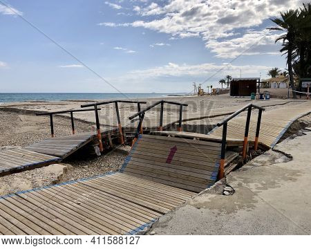 Destroyed Wooden Seafront Promenade On Campoamor Beach