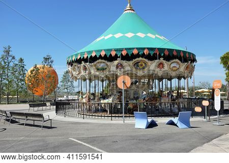 IRVINE, CA - MARCH 28, 2017: The Orange County Great Park Carousel Ride. The carousel ride is one of two current attractions at the Great Park, the other being the balloon, in the background.