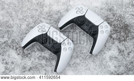 Moscow, Russia - March 8 2021: Presentation Of A New Product From Sony - A White Wireless Gamepads P