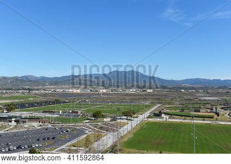 IRVINE, CALIFORNIA - 31 JAN 2020: Aerial view of the Soccer Stadium, Softball Stadium and Tennis Facility with Saddleback peak.