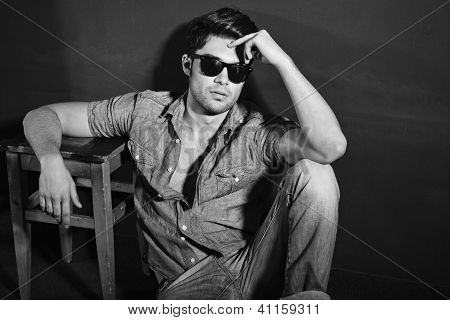 Vintage Stylized Black And White Photo Of Young Male Model (photo Has An Intentional Film Grain)