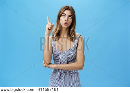 Portrait Of Beautiful Creative Cute Adult Woman Daydreaming Or Thinking Looking Up With Thoughtful E