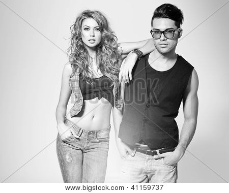 Sexy Man And Woman Doing A Fashion Photo Shoot In A Professional Studio - Bw Retro Look