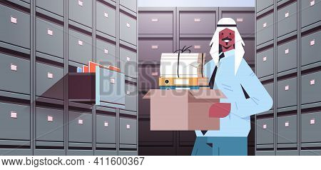 Arab Businessman Holding Cardboard Box With Documents In Filing Wall Cabinet With Open Drawer Data A