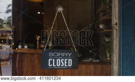 Sorry We're Closed Vintage Black And White Retro Sign On A Coffee Glass Door Cafe After Coronavirus