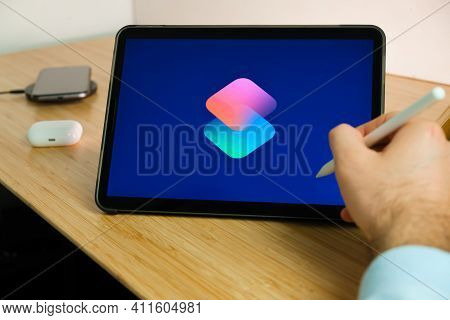 Apple Shortcuts Logo On The Screen Of Ipad Tablet. March 2021, San Francisco, Usa