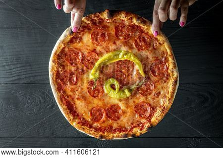 Hands Holding Pizza Pepperoni. Tasty Italian Pizza Made From An Authentic Recipe. Food Recipe Backgr