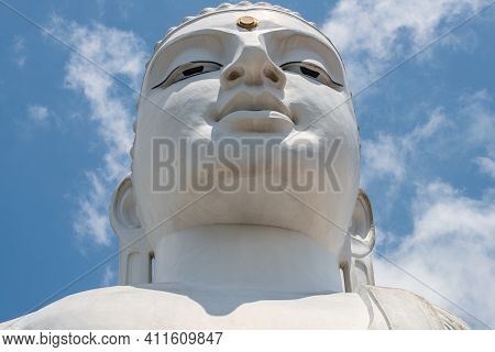 The Face Of White Giant Buddha Statue In Sri Maha Bodhi Viharaya Located On The Top Of Small Hill In